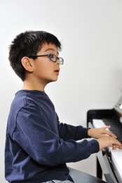 RAC Music Programs child playing piano