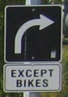 Right Turn Except Bikes Sign
